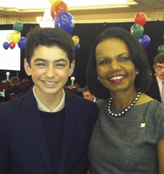 Patrick Welch with Augusta member and former Secretary of State Condoleezza Rice.